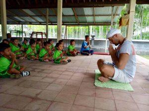 Simon our massage therapist practicing kundalini yoga in Bali