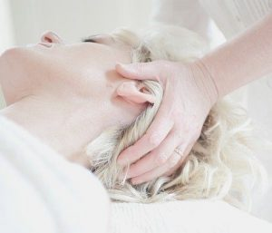 Head massage and neck stretching for neck pain